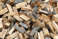 Firewood big pile of split fuel material Stock Photos