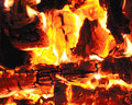 Firewood burning fireplace closeup Stock Photography