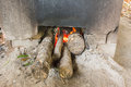 Firewood burns,Pizzas baking in an open firewood oven,fire burni Royalty Free Stock Photo