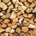 Firewood dry chopped logs in a pile Royalty Free Stock Image