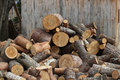Firewood logs heaped in a pile dry chopped Stock Images