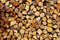 Firewood logs a pile of chopped stored in a ranch or a farm Stock Images