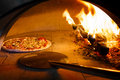Firewood oven pizza Royalty Free Stock Photo