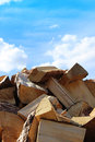 Firewood pile and blue sky with cloud closeup Royalty Free Stock Photo