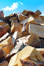 Firewood pile and blue sky with cloud closeup Stock Photo