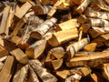 Firewoods pile of chopped birch firewood natural background Stock Photo