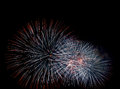 Firework bursts colorful sparkles pattern against dark sky background Stock Photography