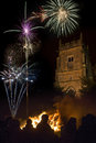 Firework display november th england a bonfire and on the near a village church in yorkshire in northeast Stock Images