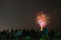 Firework many people standing on the sea and watching the fireworks at huahin thailand Stock Photos