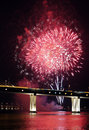 Fireworks beautiful in the sea and over bridge Royalty Free Stock Images