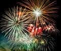 Fireworks in the dark sky background, New Year celebration fireworks.
