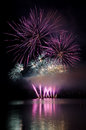 Fireworks display colorful show above the lake Stock Image