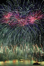 Fireworks display with green and pink sky over Gen Royalty Free Stock Photo