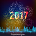 Fireworks display for happy new year 2017 above the city with clock Royalty Free Stock Photo