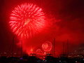 Fireworks display red at harbor night shot showing a blast of sydneys harbour into a black night sky Royalty Free Stock Image