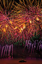 Fireworks display with yellow and pink sky over Geneva Royalty Free Stock Photo