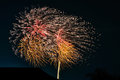 Fireworks explode over house roof contryside Royalty Free Stock Photography