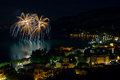 Fireworks explode in the water in garda lake Stock Image