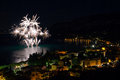 Fireworks explode in the water in garda lake Stock Photos