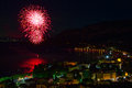 Fireworks explode in the water in garda lake Royalty Free Stock Photos