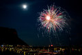 Fireworks explode in the water in garda lake Royalty Free Stock Image