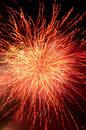 Fireworks explosion in red and gold Royalty Free Stock Photo