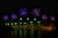 Fireworks. Fireworks explosion in dark sky with city sillouthe and colorful reflect on water in Valletta, Malta. Violet fireworks. Royalty Free Stock Photo