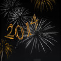 Fireworks happy new year elegant gold numbers with and silver and gold on black background for s day s eve Royalty Free Stock Photography