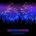 Fireworks lighting up the sky behind town houses. Royalty Free Stock Images
