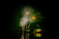 Fireworks of multiples colors on water Royalty Free Stock Photo