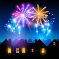 Fireworks night lighting up the sky behind town houses Royalty Free Stock Images