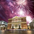 Fireworks over the Christmas and New Year holidays illumination in Moscow city center and Government building on Tverskaya street Royalty Free Stock Photo
