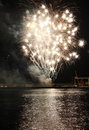 Fireworks reflect on sea water beauty of the Stock Image
