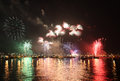 Fireworks reflect on sea water beauty of the Stock Images
