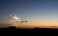 Fireworks at sunset on fourth of july Royalty Free Stock Images