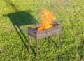 Firing barbecue after blazing of firestarter liquid Royalty Free Stock Photos