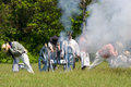 Firing a cannon at a War of 1812 re-enactment Stock Photography