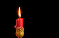 Firing red candle in vintage candlestick on dark background Stock Photography