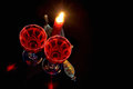 Firing red candle in vintage candlestick and two winglasses of wine on dark background Stock Image