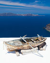 Firostefani santorini greece boat on a roof at near fira in the background is skaros rock at imerovigli Royalty Free Stock Photo