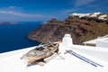 Firostefani santorini greece boat on a roof at near fira in the background is skaros rock at imerovigli Royalty Free Stock Photos