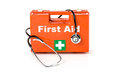 First aid kit with stethoscope on a white background Royalty Free Stock Photo