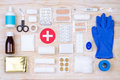 First aid kit on wooden background Royalty Free Stock Photo