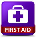 First aid purple square button red ribbon in middle Royalty Free Stock Photo