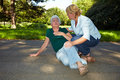 First aid for senior woman Royalty Free Stock Photography