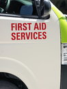 First Aid services printing on a transport van body Royalty Free Stock Photo