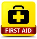 First aid yellow square button red ribbon in middle Royalty Free Stock Photo
