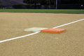 First base for men women soft ball on fresh sandy dirt ready for fist game Royalty Free Stock Photos