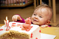 First birthday little toddler with a cake at home Stock Photo