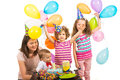First birthday party of boy celebrate with his family mother and sisters with cake and balloons Stock Photos